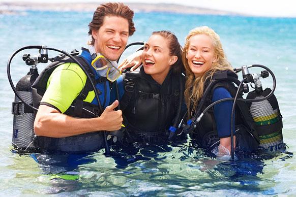 scuba divers wearing wetsuits